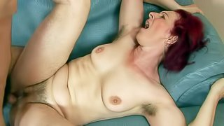 Debra is a fuck hungry red-haired mature woman with bushy pussy and hairy armpits. She gets her muff fucked hard by thick dicked boy. She takes his young sturdy dick deep in her vagina before he shoot shoots his load